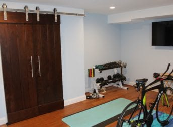 Who does home remodeling for a workout room in the basement. It also includes a laundry room and powder room