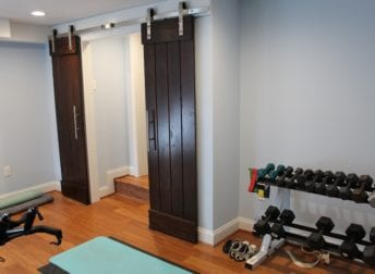 Who does home remodeling for a home gym like this one Talon Construction built in Frederick